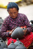 Nepalese woman working in the her pottery workshop — Stock Photo