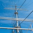 Mast yacht without sails against the blue sky — Stock Photo