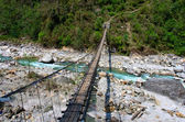 Rope hanging suspension bridge, Nepal — Stock Photo