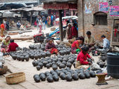 Nepalese people working in the her pottery workshop — Stock Photo