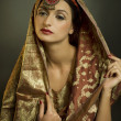 Beautiful brunette portrait with traditional costume. — Stock Photo #4895997