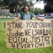 Постер, плакат: Protester at Zimmerman Trial