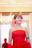 The girl bride in a red dress — Stock Photo