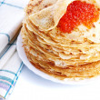 Pile of pancakes on plate with red caviar — Stock Photo #23148892