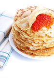 Pile of pancakes on a plate with red caviar — Stock Photo