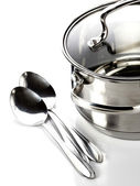 Pan and spoons — Stock Photo