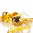 Gold mirror sphere and New Year's tinsel. — Stock Photo