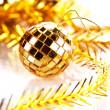 Gold mirror sphere and Christmas tinsel. — Stock Photo
