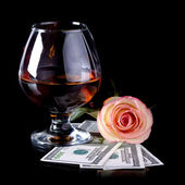 Glass, rose and dollars. — Stock Photo