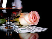 Glass, rose and money. — Stock Photo