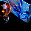 Alcohol and gift — Stock Photo