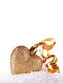 Heart with gold tape on snow — Zdjęcie stockowe