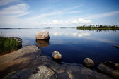 Stone coast of the lake. — Stock Photo