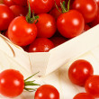 Basket Of Red Cherry Tomatoes - Stock Photo