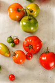 Overhead View Of Red And Green Homegrown Tomatoes — Stock Photo