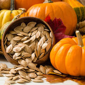 Orange Pumpkins With Toasted Pumpkin Seeds — Stock Photo