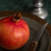 Red Pomegranate On A Pewter Plate — Stock Photo