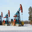 "Column labeled ""Gas"" on the background of oil pump jacks — Foto Stock"