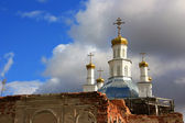Domes of old orthodox church on a background cloudy sky — Stock Photo