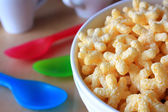 Breakfast - cereal in the form of stars in the bowl — Stock Photo