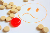 Painted smiley of tablets — Stock Photo