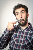 Young man want comb his beard and moustaches — Stock Photo