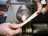 Hobby of craftmanship of wood with lathe — Stock Photo