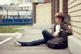 School teen with scholbag and skateboard — Stock Photo