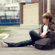 School teen with schollbag and skateboard — Stock Photo