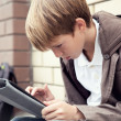 School teen with electronic tablet sitting — Stock Photo #12428682