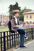 Portrait of teenager in jacket, outdoor — Stock Photo