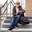 Serious boy sitting on stairs. outdoor — Stock Photo