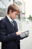 School boy with electronic tablet — 图库照片