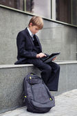 School boy with electronic tablet sitting, — Foto de Stock
