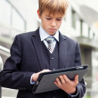 School boy with electronic tablet — Stock Photo
