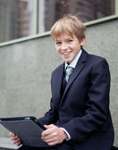School boy with electronic tablet sitting, — Stockfoto