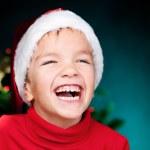 Happy small boy in santa hat — Stock Photo #13110622