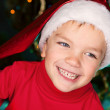Happy small boy in santa hat — Stock Photo