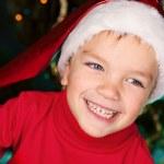 Happy small boy in santa hat — Stock Photo
