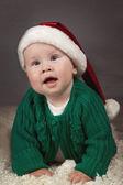 Happy small kid in santa hat — Stock Photo