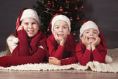 Children are around Christmas tree. — Stock Photo