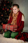 Happy girl holding Christmas present — Stock Photo