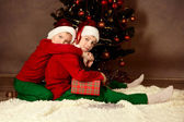 Two brothers in Santa hats, Christmas — Stock Photo