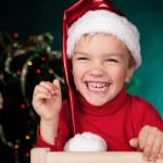 Happy small boy in santa hat — Stock Photo #14122883