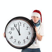 Teenager in cap of Santa Claus and large clock, isolation — Stock Photo