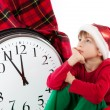 Stock Photo: Baby in Santa Claus hat waiting for gift