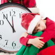 Baby in Santa Claus hat waiting for gift — Stockfoto