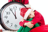 Baby in Santa Claus hat waiting for gift — Stock Photo