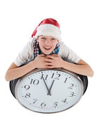 Teenager in cap of Santa Claus and large clock, isolation — 图库照片