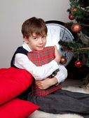 Happy child hugs Christmas gift — Stock Photo